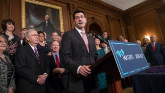 Speaker of the House Paul Ryan, R-Wis., joined by, from left, House Budget Committee Chair Diane Black, R-Tenn., Senate Majority Leader Mitch McConnell, R-Ky., and House Ways and Means Committee Chairman Kevin Brady, R-Texas, praises the Republican tax bill before signing the final version during an enrollment ceremony at the Capitol in Washington, Thursday, Dec. 21, 2017. (AP Photo/J. Scott Applewhite)
