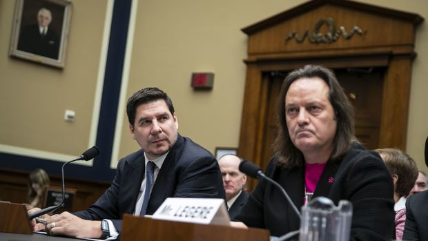 Marcelo Claure, chairman of Sprint Corp. and chief operating officer of SoftBank Group Corp., left, and John Legere, chief executive officer of T-Mobile US Inc., listen during a House Energy & Commerce subcommittee hearing on the the T-Mobile and Sprint merger on Capitol Hill in Washington, D.C., U.S., on Wednesday, Feb. 13, 2019. Legere says his company doesn't use equipment from Huawei Technologies Co., and won't after buying Sprint Corp. to form a bigger No. 3 in the U.S. wireless market. Photographer: Al Drago/Bloomberg via Getty Images