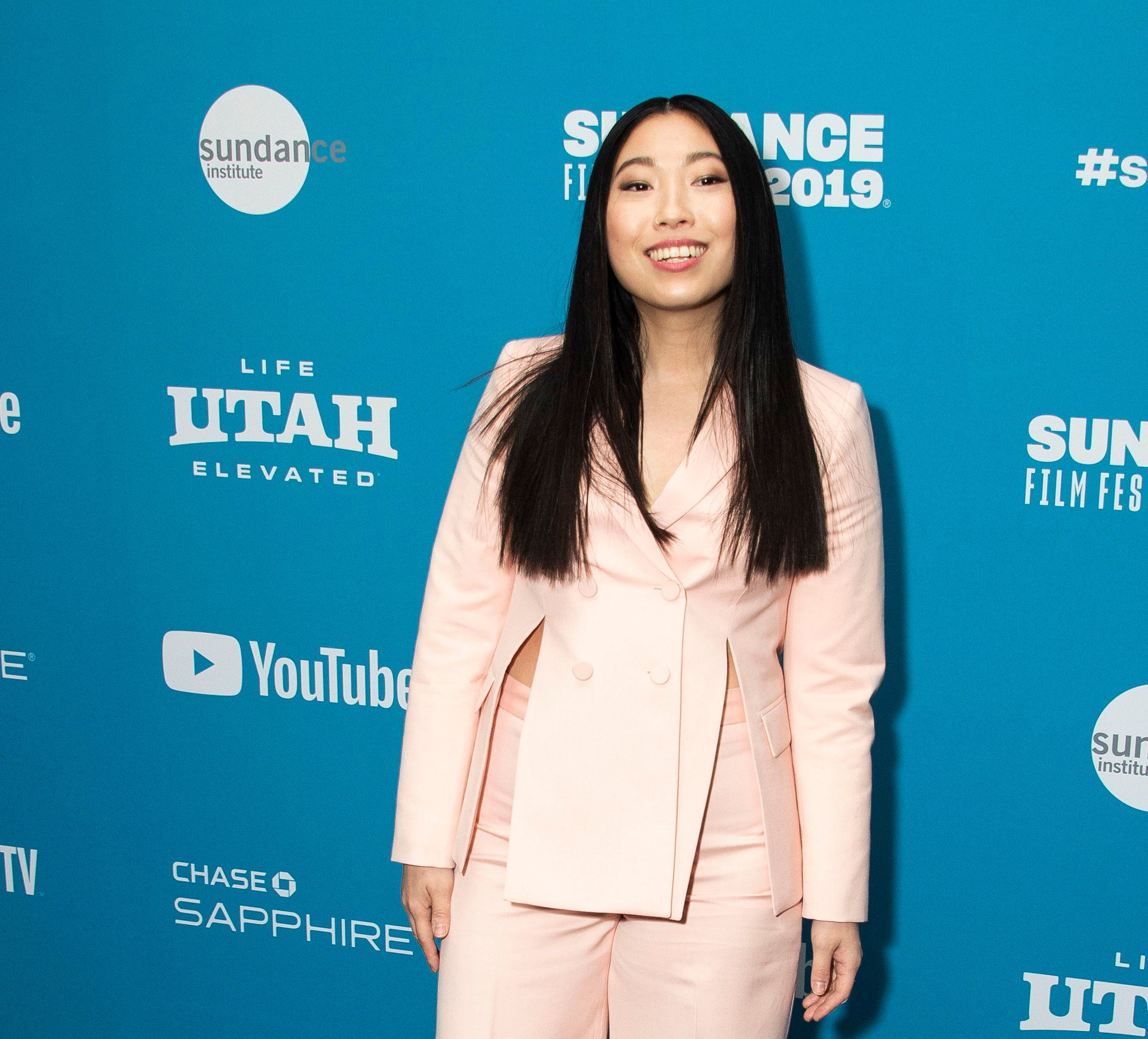 """Actress Awkwafina poses at the premiere of """"Paradise Hills"""" during the 2019 Sundance Film Festival, Saturday, Jan. 26, 2019, in Park City, Utah. (Photo by Arthur Mola/Invision/AP)"""