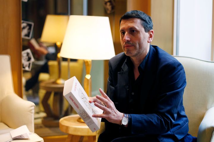 French writer Frederic Martel gestures during an interview with Associated Press, in Paris, Friday, Feb. 15, 2019.