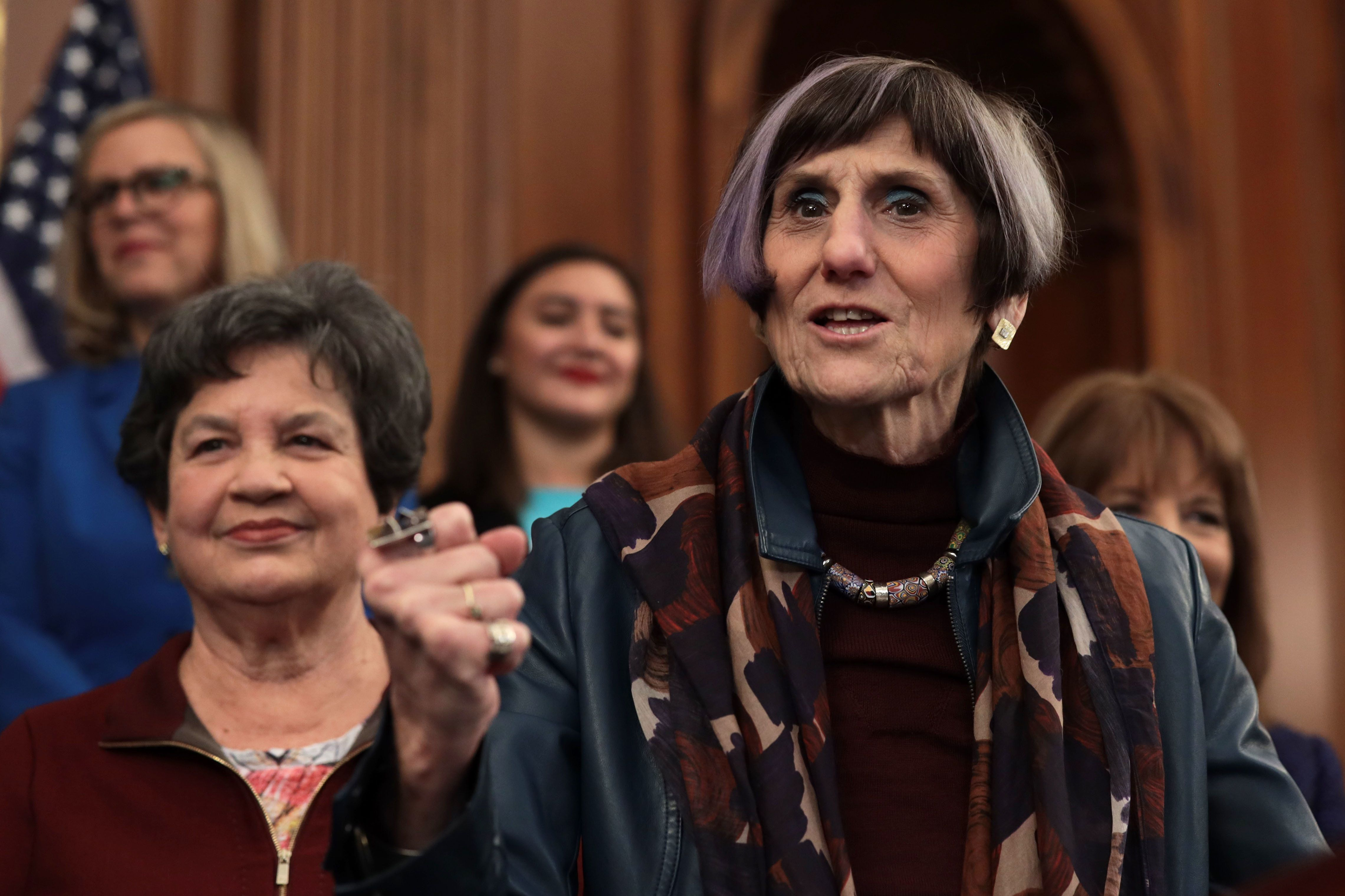 WASHINGTON, DC - JANUARY 30:   U.S. Rep. Rosa DeLauro (D-CT) (R) speaks as Rep. Lois Frankel (D-NY) (L) listens during a news conference at the U.S. Capitol January 30, 2019 in Washington, DC. House Democrats held a news conference to introduce the 'Paycheck Fairness Act.'  (Photo by Alex Wong/Getty Images)