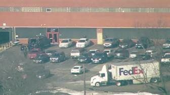 The scene outside an industrial building where an alleged mass shooting has taken place in Aurora, Illinois