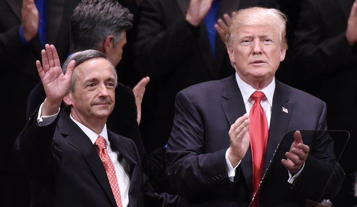 Pastor Robert Jeffress waves next to President Donald Trump at an event at the Kennedy Center in Washington, D.C., on July 1, 2017.