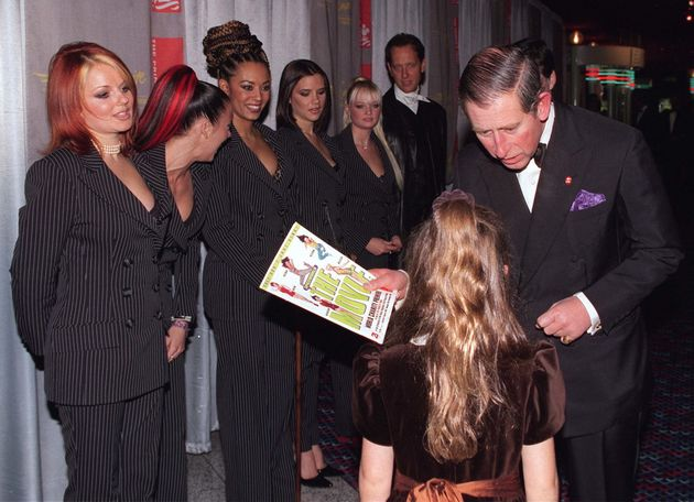 The Spice Girls and Richard E. Grant wait to meet Prince Charles at the 1997 premiere of