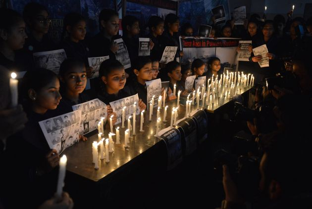 School students hold candles as they pay tribute to the CRPF personnel killed in Pulwama