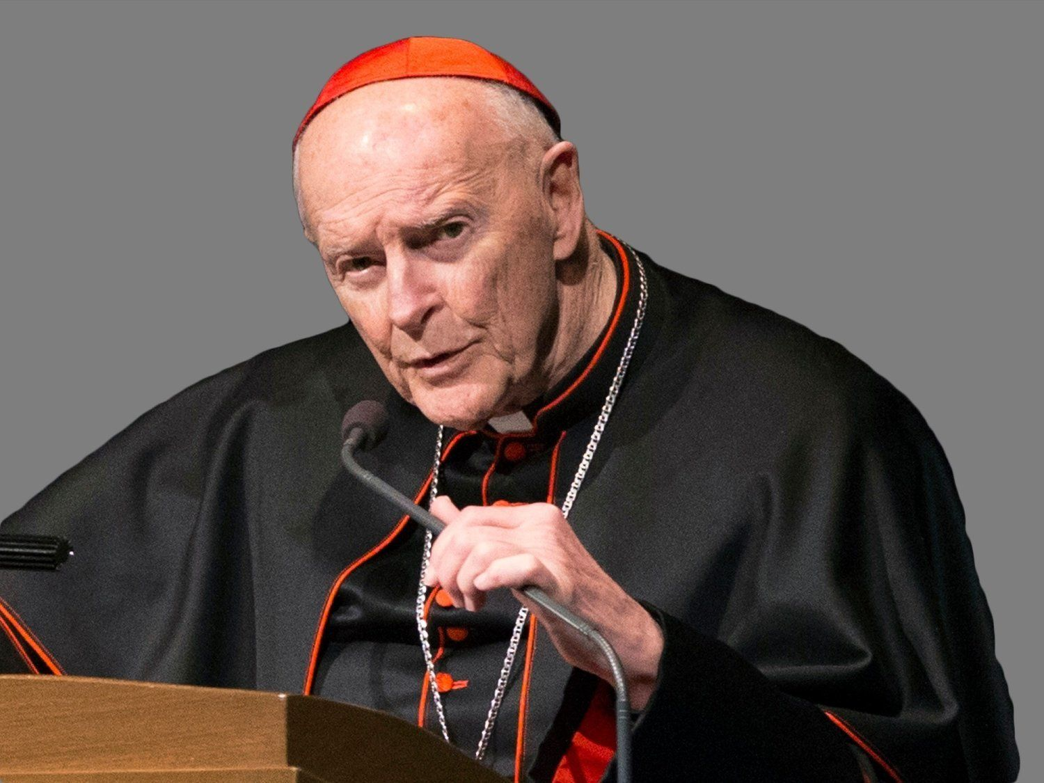 Theodore Edgar McCarrick headshot, retired Catholic Archbishop of Washington DC, graphic element on gray