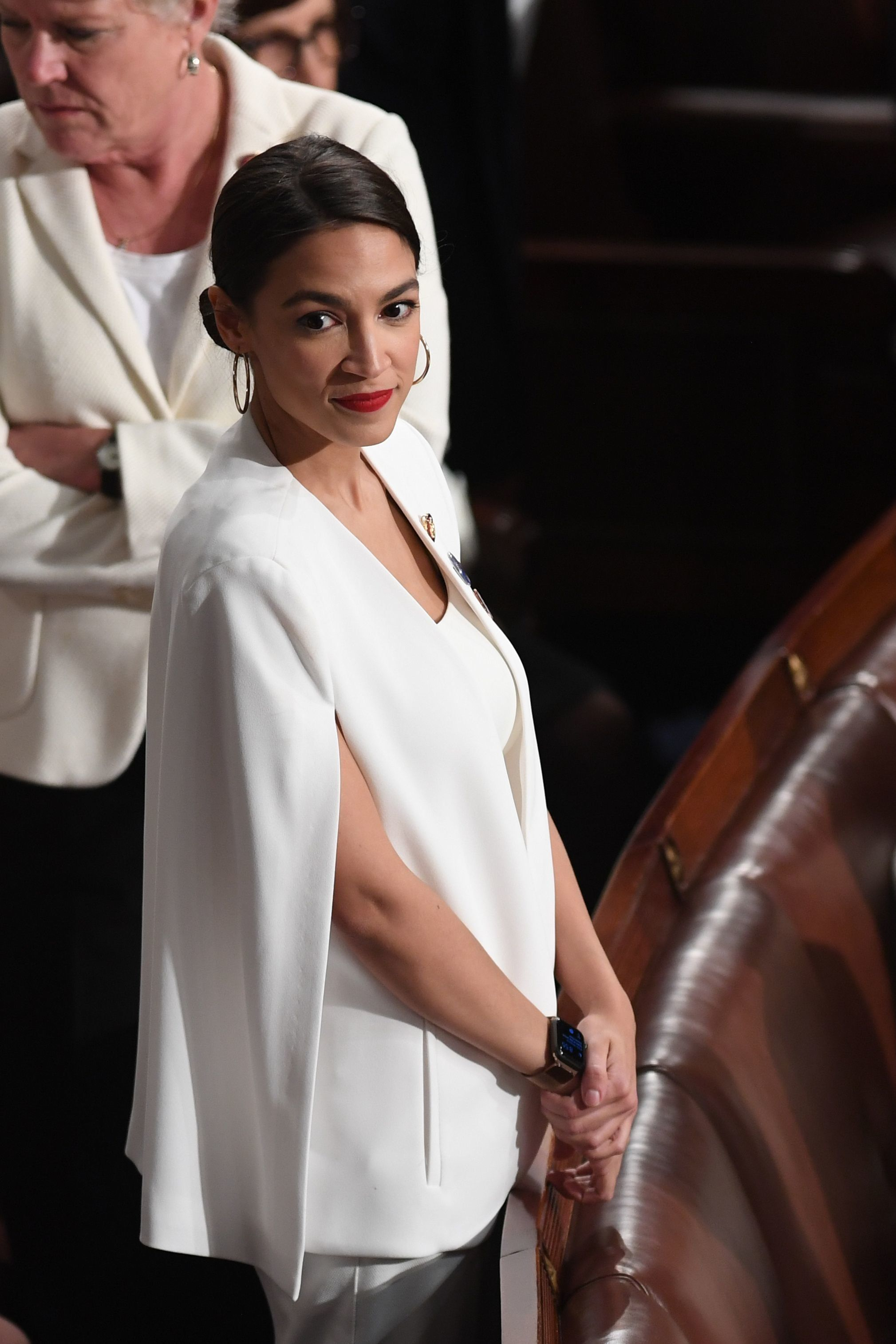 US Representative Alexandria Ocasio-Cortez (D-NY), dressed in white in tribute to the women's suffrage movement, arrives for the State of the Union address at the US Capitol in Washington, DC, on February 5, 2019. (Photo by SAUL LOEB / AFP)        (Photo credit should read SAUL LOEB/AFP/Getty Images)