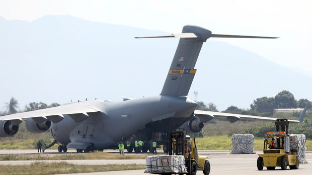 Humanitarian aid is unloaded from an United States Air Force C-17 cargo plane, at Camilo Daza airport in Cucuta, Colombia, Saturday, Feb. 16, 2019. The U.S. Air Force has begun flying tons of aid to a Colombian town on the Venezuelan border as part of an effort meant to undermine socialist President Nicolas Maduro.(AP Photo/Fernando Vergara)