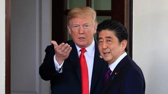FILE - In this June 7, 2018 file photo, President Donald Trump welcomes Japanese Prime Minister Shinzo Abe to the White House in Washington. Asia is paying more attention than usual to the U.S. midterm elections, thanks to Trump. Anxiety hangs over the region on whether a Democratic victory would significantly alter the Trump administration's major initiatives in foreign policy and trade. Japan has been forced to enter trade talks with the United States following Trump's threat to impose tariffs on imported cars and auto parts, which alarmed Japanese automakers. (AP Photo/Manuel Balce Ceneta, File)
