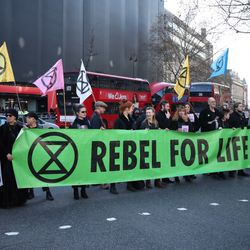 Climate Change Protesters Descend On London Fashion