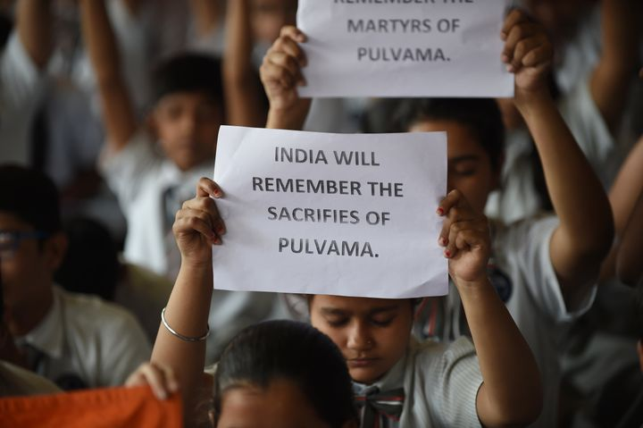 Indian school students pay tribute to the CRPF personnel killed in Kashmir on February 14.