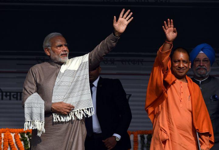Narendra Modi and Yogi Adityanath during a public rally in Noida on December 25, 2017.