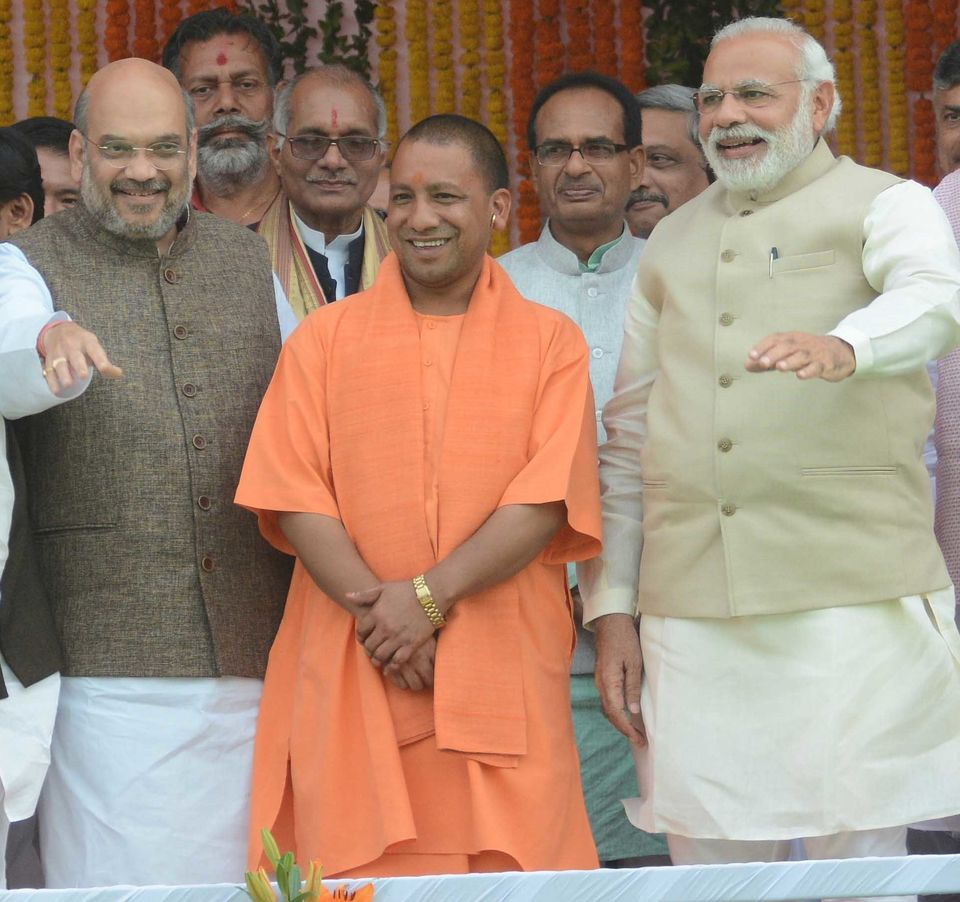 Amit Shah, Yogi Adityanath and Narendra Modi during the swearing-in ceremony in Lucknow on March 19,