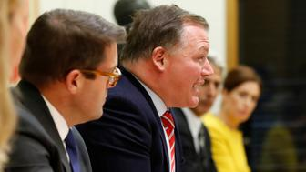"Britain's Damian Collins, centre, speaks during a press conference for the Digital, Culture, Media and Sport Committee in London, Tuesday, Nov. 27, 2018. 8 different Parliaments from all over the world, known as the ""International Grand Committee on Disinformation and 'fake news'"" gathered for a special evidence session. (AP Photo/Frank Augstein)"