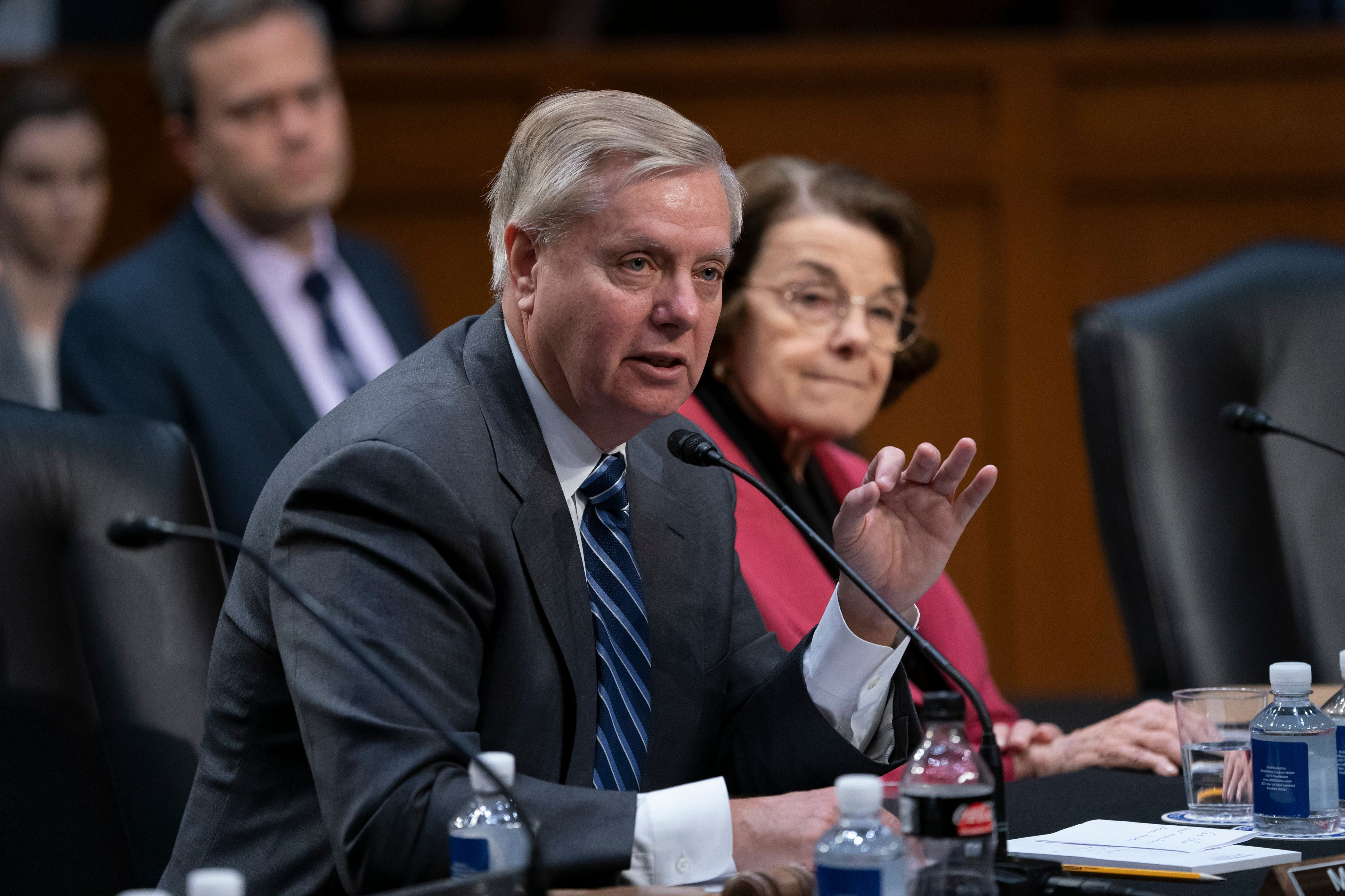 Senate Judiciary Committee Chairman Lindsey Graham, R-S.C., joined at right by Sen. Dianne Feinstein, D-Calif., the ranking member, speaks on the nomination of Bill Barr to be attorney general, on Capitol Hill in Washington, Thursday, Feb. 7, 2019. Barr's nomination now goes to the whole Senate for consideration. (AP Photo/J. Scott Applewhite)