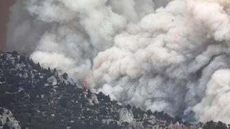 IDYLLWILD, CA - JULY 26: The Cranston Fire burns in San Bernardino National Forest on July 26, 2018 near Idyllwild, California. Fire crews are battling the 4,700-acre fire in the midst of a heat wave.  (Photo by Mario Tama/Getty Images)
