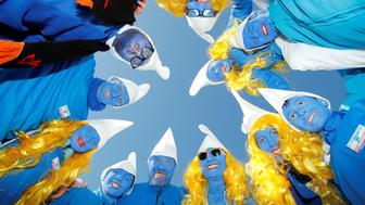Participants dressed as smurfs pose during an attempt to hold the world's largest meeting of smurfs in a bid to outdo the previous record of 2,510 mostly student participants in Wales in 2009 in Lauchringen, Germany February 16, 2019.  REUTERS/Arnd Wiegmann     TPX IMAGES OF THE DAY