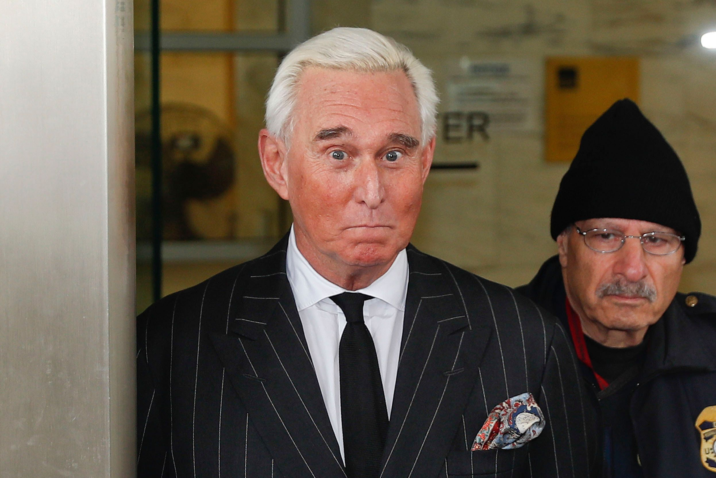 FILE - In this Feb. 1, 2019 file photo, former campaign adviser for President Donald Trump, Roger Stone, leaves federal court in Washington.  (AP Photo/Pablo Martinez Monsivais)