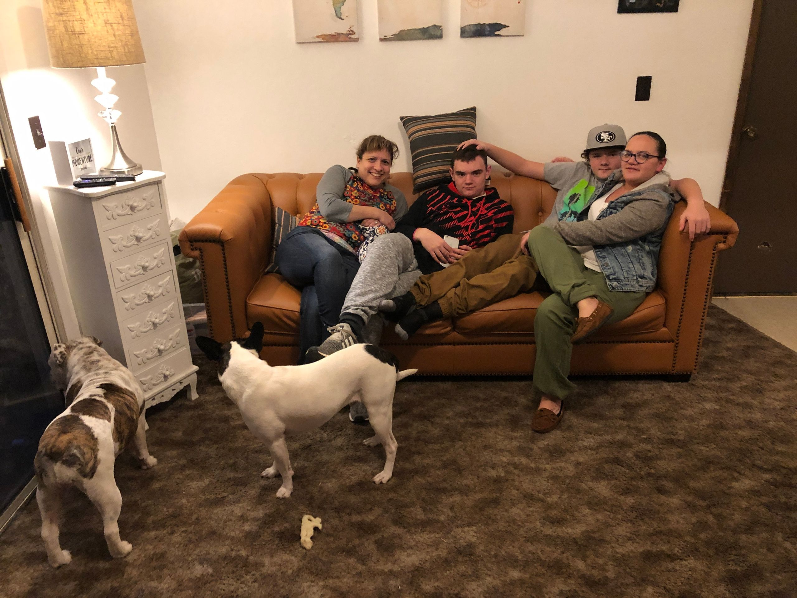 (From left) Stacy Hawley and Dexter, Braxton and Pamela Howell in the living room of their new rental, months after losing th