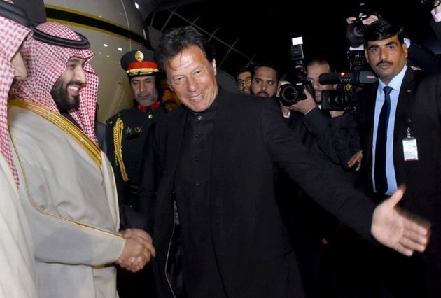 In this photo released by the Press Information Department, Pakistani Prime Minister Imran Khan, centre,...