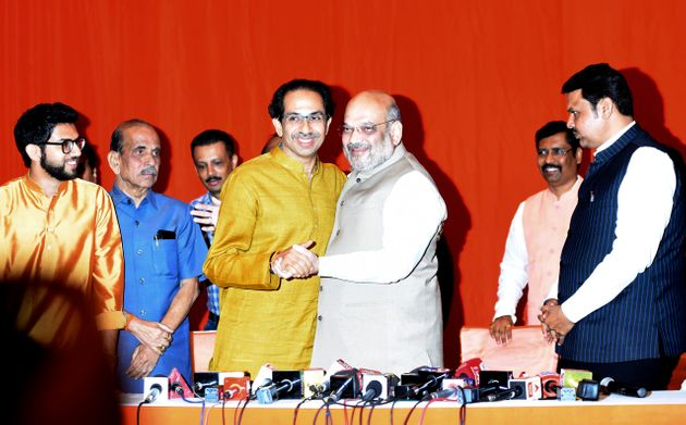 Shiv Sena chief Uddhav Thackeray with BJP president Amit Shah and Maharashtra CM Devendra Fadnavis at...