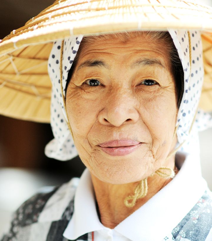 An Okinawan woman in traditional clothing. People on the islands have among the longest life spans in the world.