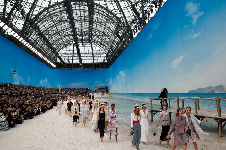 Karl Lagerfeld, top right, watches as models wear creations for the Chanel Spring/Summer 2019 ready-to-wear fashion collection in Paris, on Oct. 2, 2018.