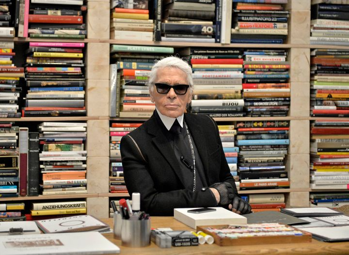 Karl Lagerfeld poses for photographers in front of his books prior to the start of an exhibition at the museum Folkwang in Essen, Germany, on Feb. 14, 2014.
