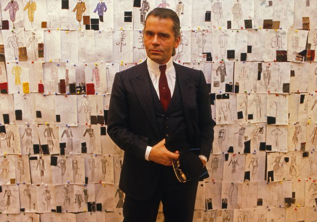Lagerfeld photographed in front of his sketches at Chanel in 1984, the year after he was appointed as...