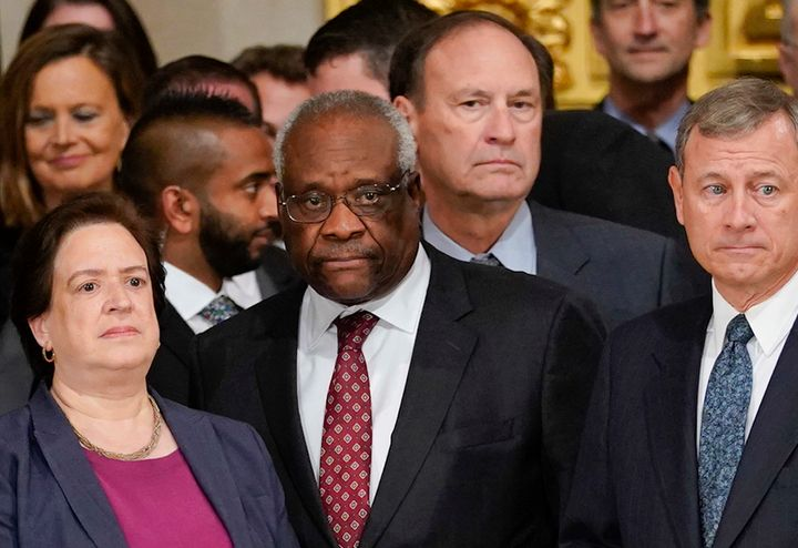Justice Clarence Thomas (center) called for a re-evaluation of a 1964 Supreme Court ruling that could have major First Amendm