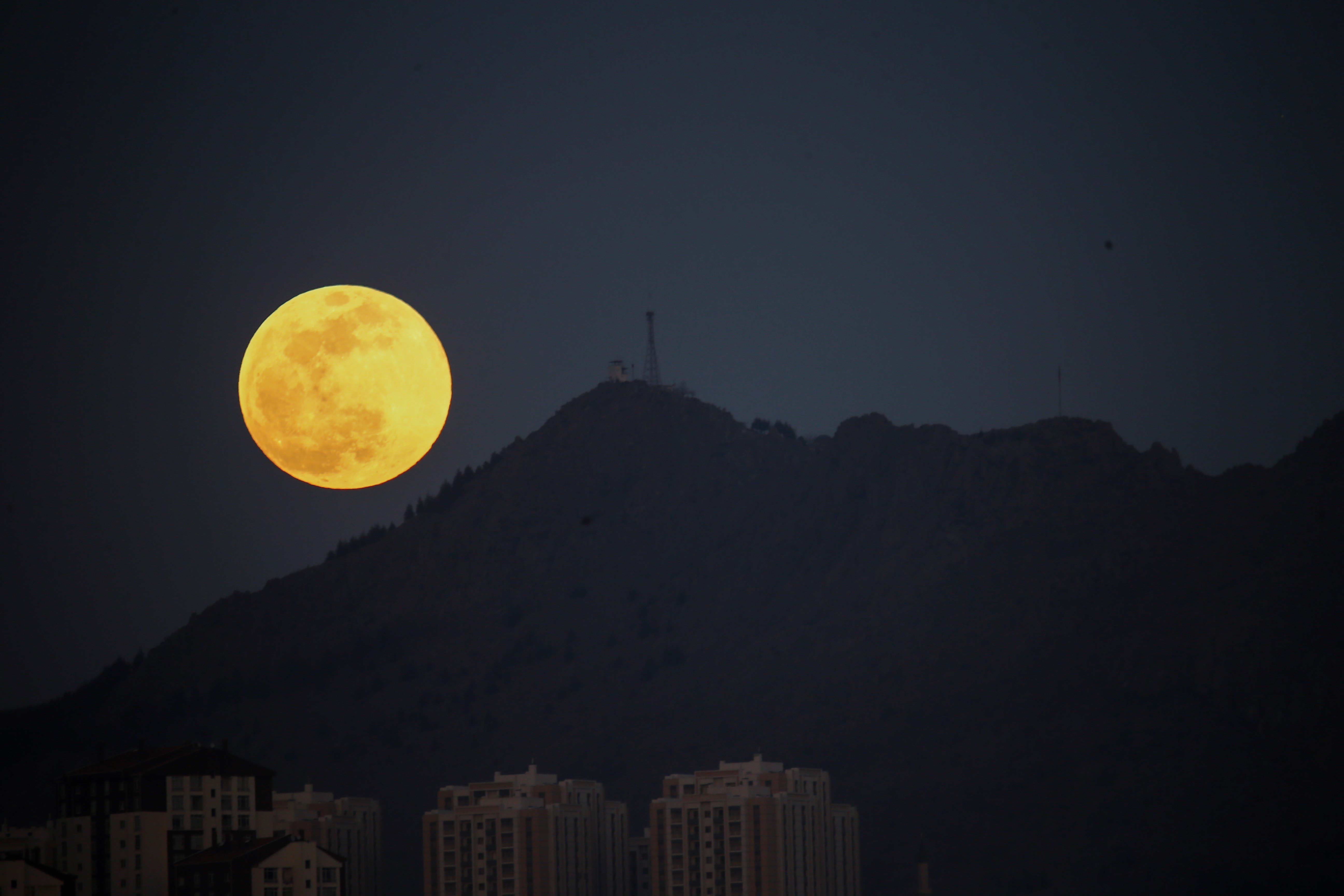 ANKARA, TURKEY - FEBRUARY 19: Supermoon is seen over Turkey's capital Ankara on February 19, 2019. A supermoon is a full moon that almost coincides with the closest distance that the Moon reaches to Earth in its elliptic orbit, resulting in a larger-than-usual visible size of the lunar disk as seen from Earth. (Photo by Dogukan Keskinkilic/Anadolu Agency/Getty Images)