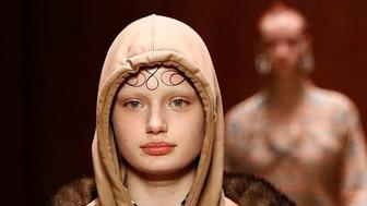 """Burberry has apologised and removed a """"noose"""" from its collection after a model who walked in its London Fashion Week show complained of being """"triggered"""" by the accessory."""