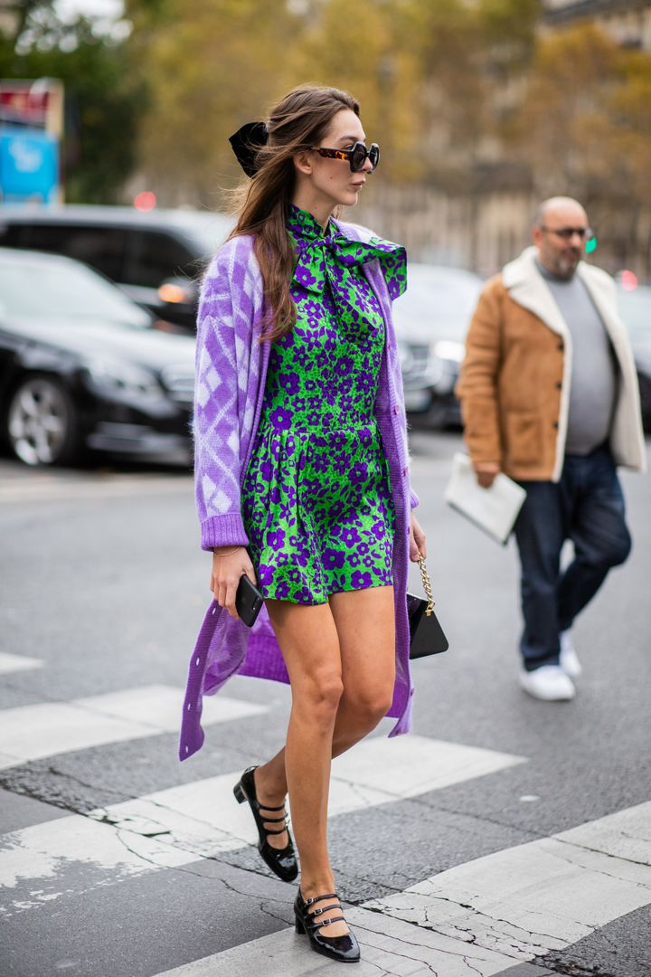 Style consultant Estelle Pigault wears a purple cardigan atop a green floral dress in Paris.