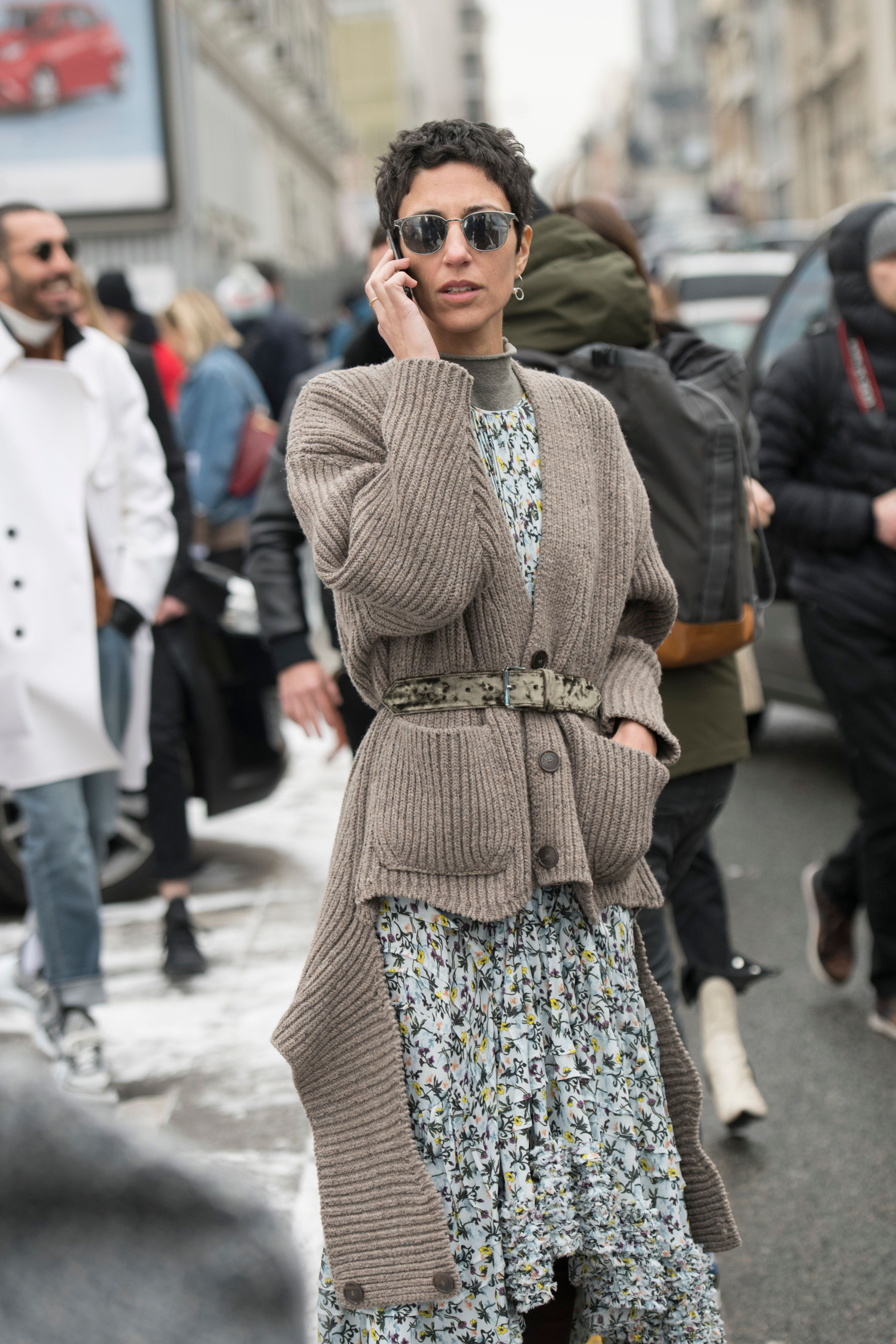Yasmin Sewell,vice president of style and creative at Farfetch, wears a floral dress wrapped in a belted, chunky cardigan in London.
