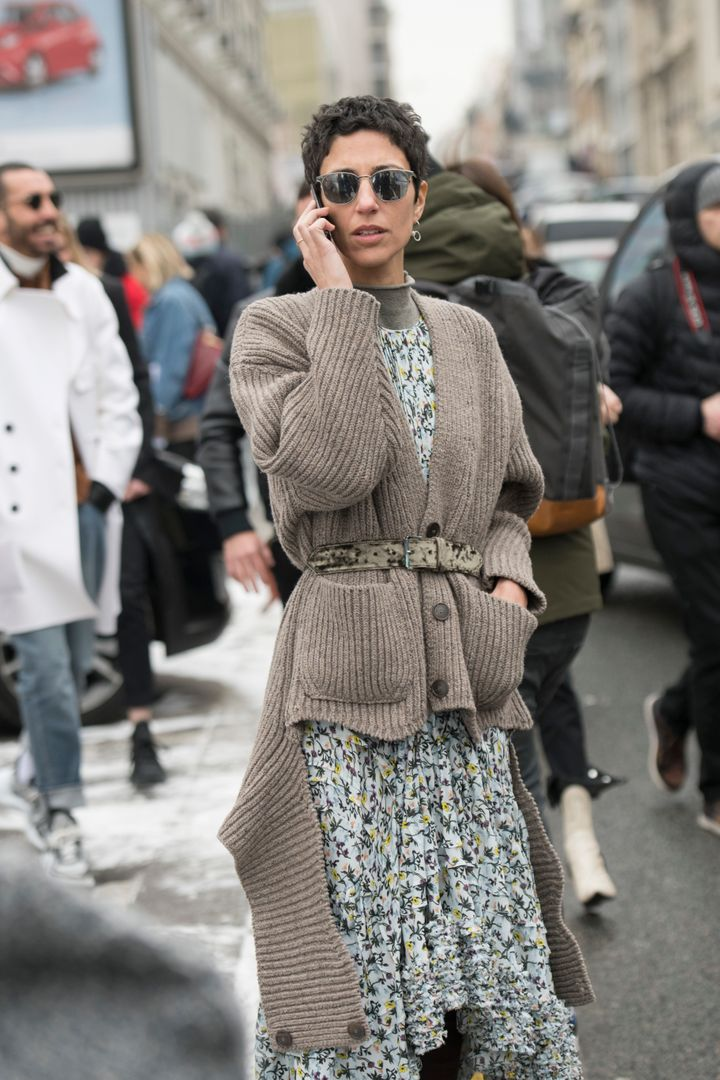 Yasmin Sewell, vice president of style and creative at Farfetch, wears a floral dress wrapped in a belted, chunky cardigan in London.