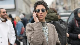 PARIS, FRANCE - MARCH 1 : Vice president of style and creative at Farfetch Yasmin Sewell wears a Chloe dress and a Balenciaga cardigan day 4 of Paris Womens Fashion Week Spring/Summer 2018, on March 1, 2018 in London, England. (Photo by Kirstin Sinclair/Getty Images)