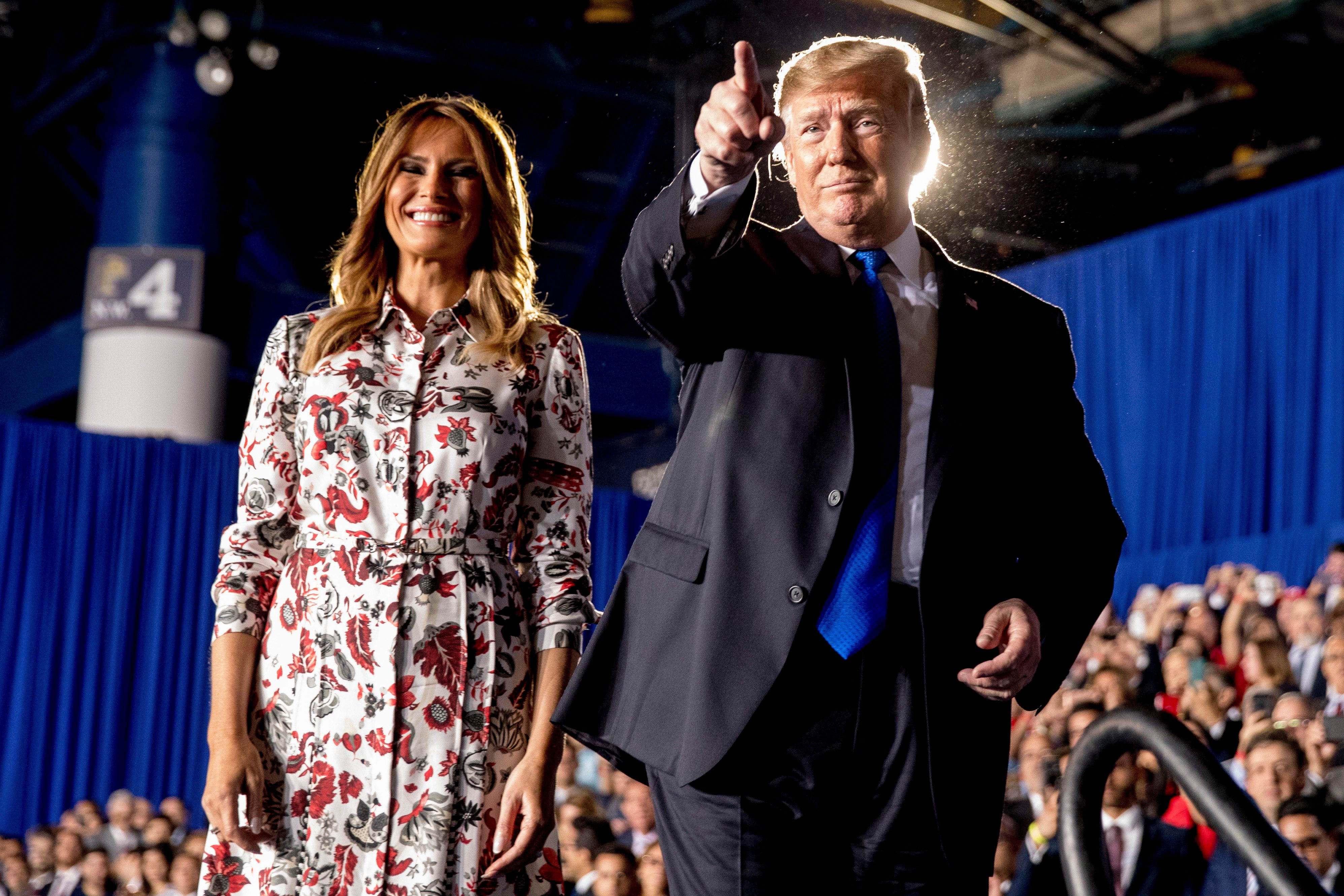 President Donald Trump and first lady Melania Trump take the stage in front of a Venezuelan American community at Florida Ocean Bank Convocation Center at Florida International University in Miami, Fla., Monday, Feb. 18, 2019, to speak out against President Nicolas Maduro's government and its socialist policies. (AP Photo/Andrew Harnik)
