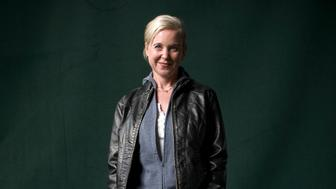 Acclaimed American musician and singer with the band Throwing Muses, Kristin Hersh, pictured at the Edinburgh International Book Festival where she talked about her life as told through her newly-published autobiography. The three-week event is the world's biggest literary festival and is held during the annual Edinburgh Festival. The 2011 event featured talks and presentations by more than 500 authors from around the world. (Photo by Colin McPherson/Corbis via Getty Images)