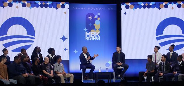 Former President Barack Obama and NBA star Steph Curry speak at a My Brother's Keeper event in Oakland,...