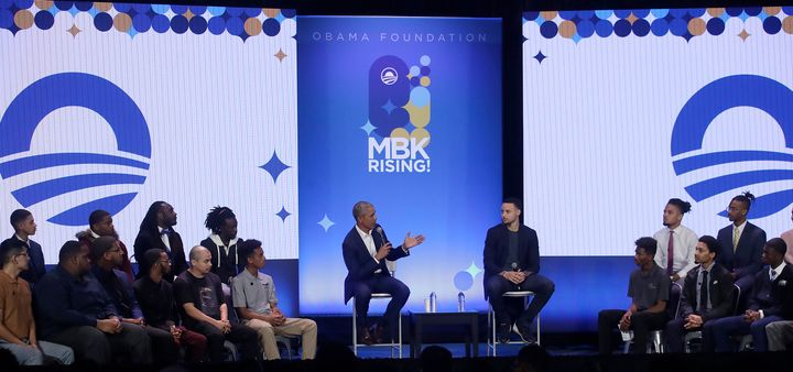 Former President Barack Obama and NBA star Steph Curry speak at a My Brother's Keeper event in Oakland, California, on Tuesda