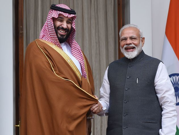 Prime Minister Narendra Modi shakes hands with Saudi Crown Prince Mohammed bin Salman prior to a meeting...
