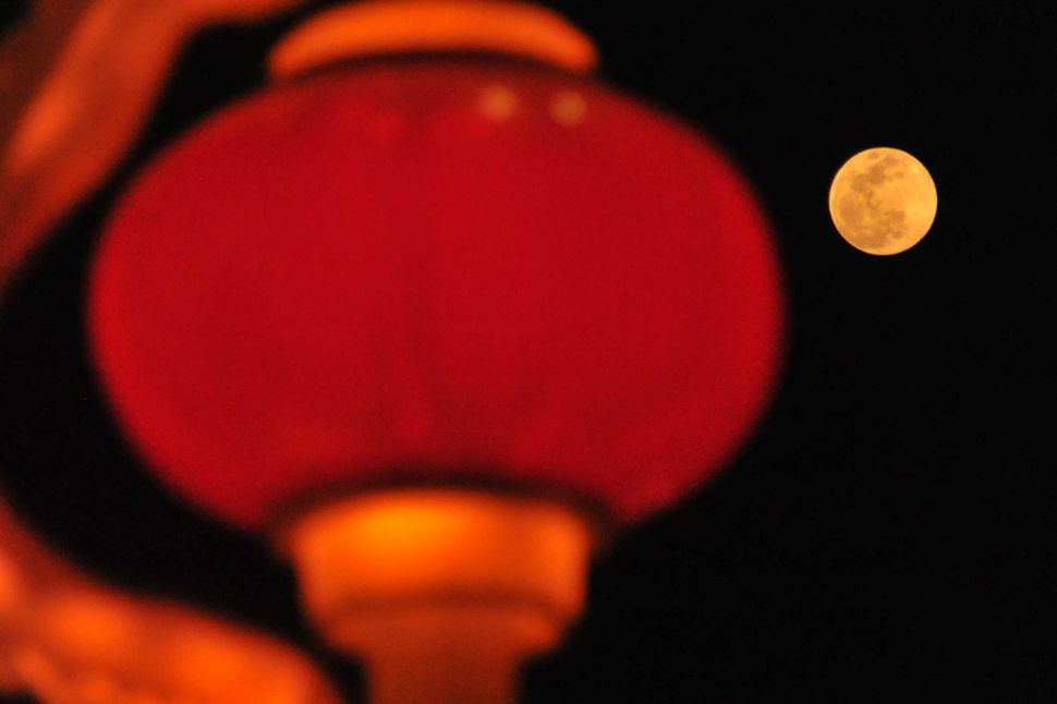The supermoon is seen near a Chinese red lantern during the Lantern Festival in Yuncheng, Shanxi Province of China.