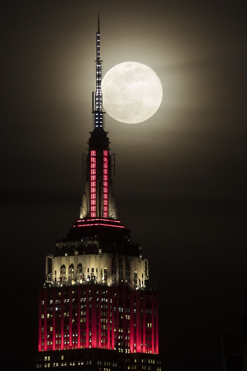 The Empire State Building is seen as the supermoon rises in New York.
