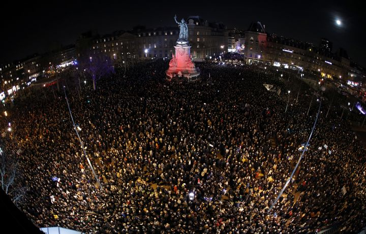 A photo, taken with a fish-eye lens, shows people attending a national gathering at Place de la Republique to protest th