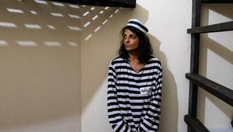 "Journalist Nina Lakhani in ""The Dungeon"", a hostel prison for guests to pay their crimes against Planet Earth by using plastic bottles."