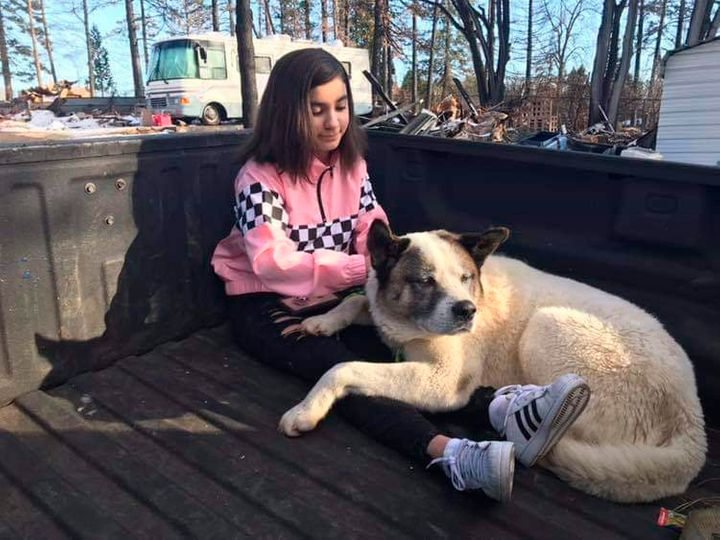 Maleah Ballejos, reunited with her dog, Kingston, in Paradise, California, on Feb. 18.