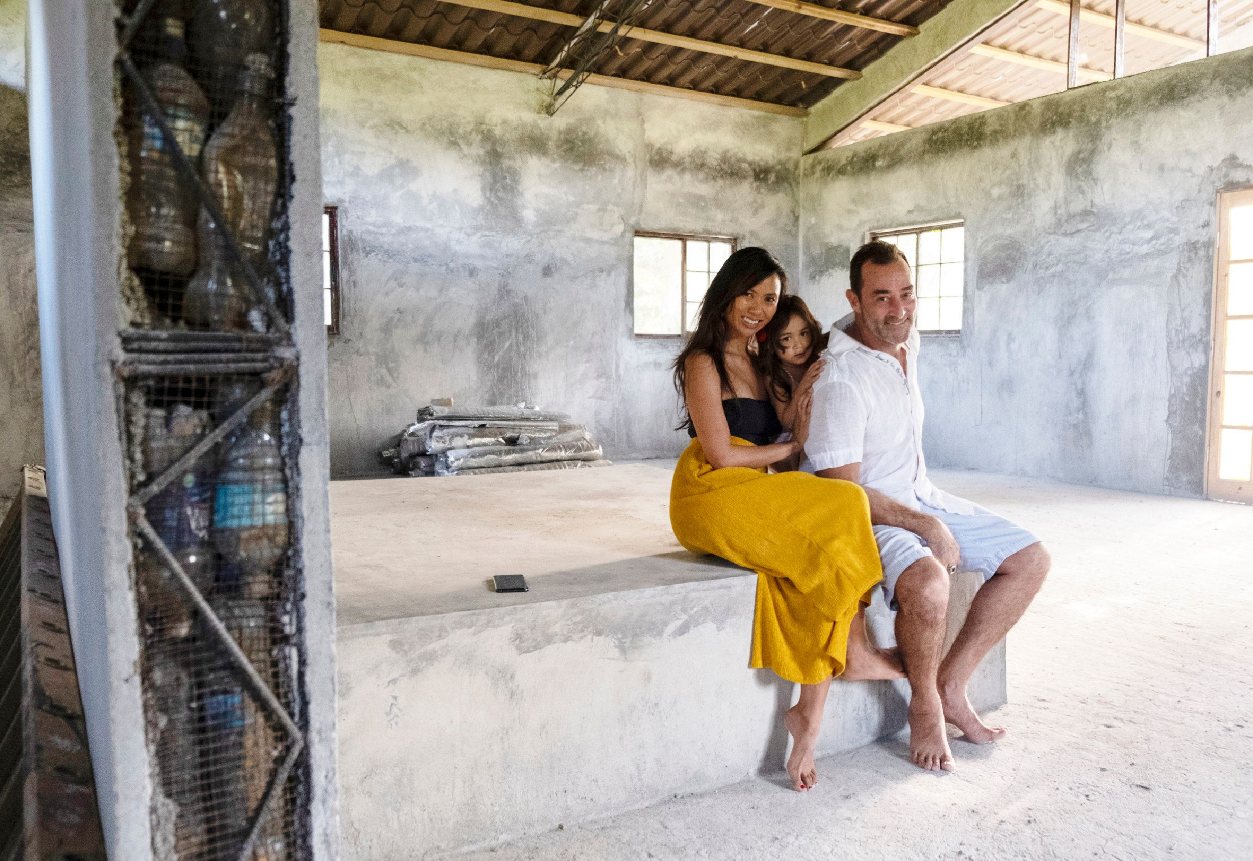 Jeff Catalano, Justine Catalano and daugther Jay, in their house made of plastic bottles on Isla Colón, Panama. The ho