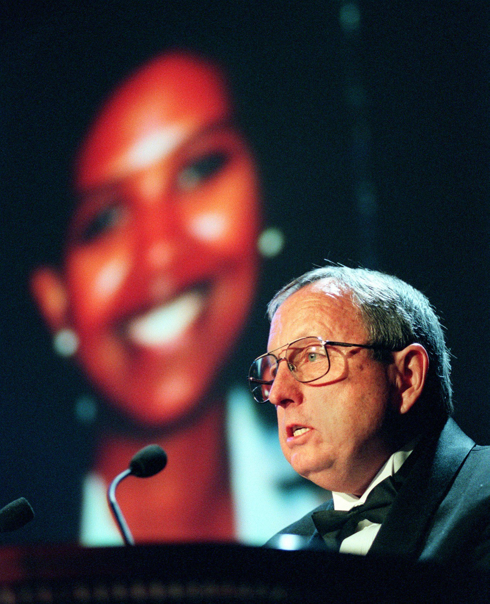 NEW YORK, UNITED STATES:  Goodloe Sutton (R), a newspaper editor from Alabama, presents the International Press Freedom Award in recognition of Agence France-Presse Eritrean correspondent Ruth Simon (L, photo on screen) 24 November during a ceremony sponsored by the 'Committee To Protect Journalists' in New York. Simon, unable to attend, has been held in detention since 25 April 1997 for reporting that Eritrean troops were fighting alongside rebel forces in neighboring Sudan. Gremah Boucar of Niger, Gustavo Gorriti, a Peruvian currently living in Panama, Goenawan Mohamad of Indonesia and Pavel Sheremet of Belarus were also recipients.  AFP PHOTO Stan HONDA (Photo credit should read STAN HONDA/AFP/Getty Images)