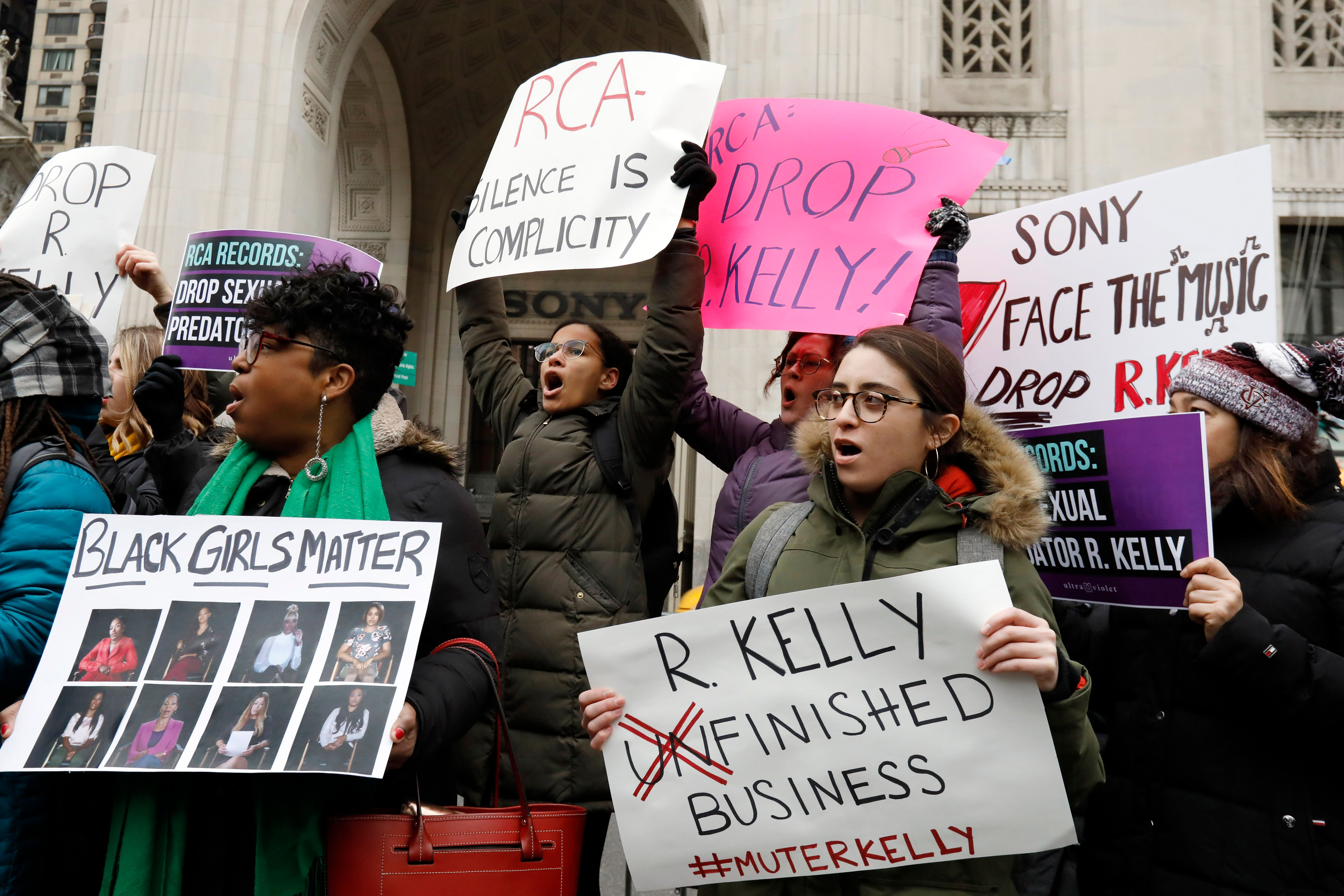 "Demonstrators chant during an R. Kelly protest outside Sony headquarters, in New York, Wednesday, Jan. 16, 2019.  Kelly has been under fire since the recent airing of a Lifetime documentary ""Surviving R. Kelly ."" He has denied all allegations of sexual misconduct involving women and underage girls. (AP Photo/Richard Drew)"