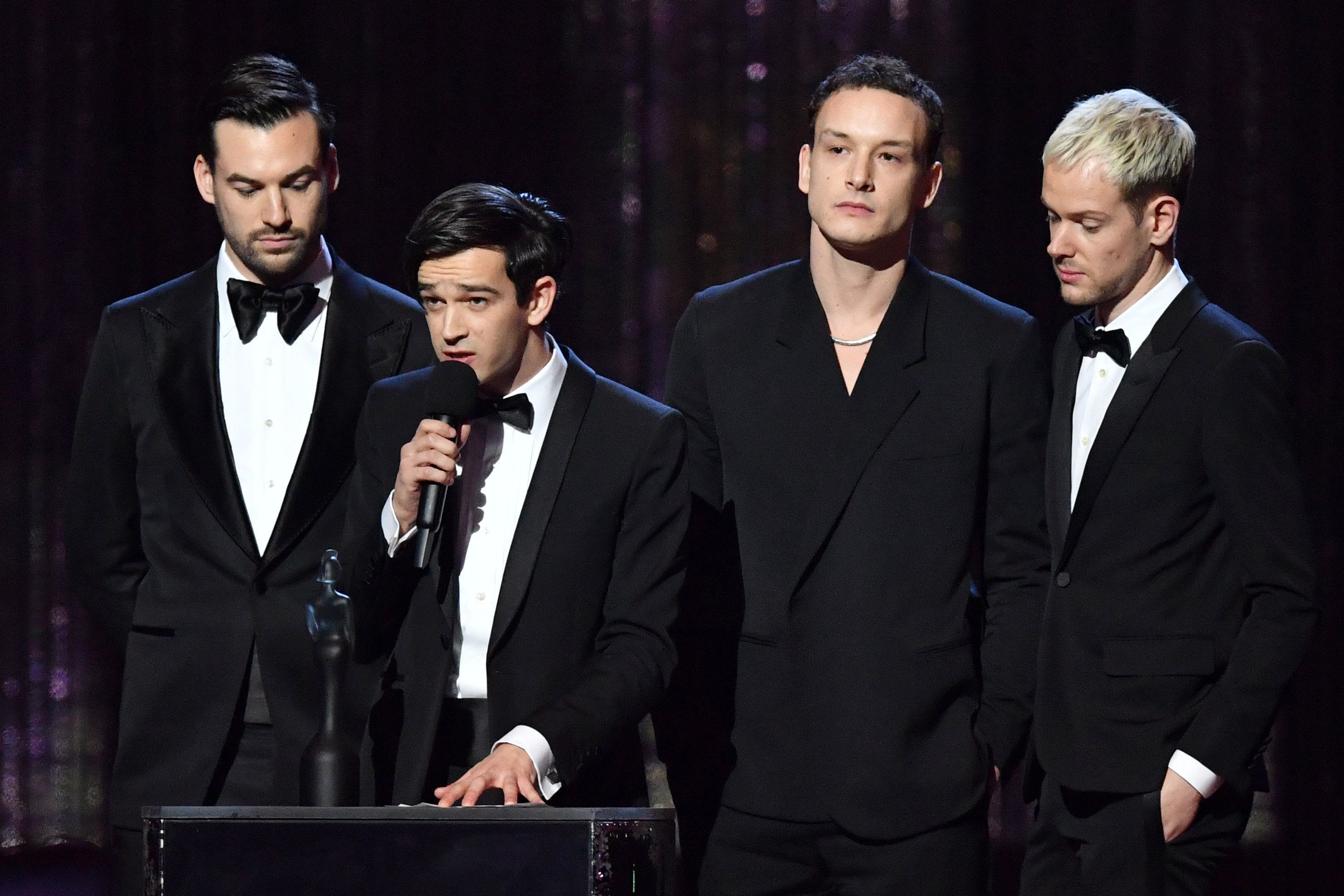 The 1975 collecting one of their two awards
